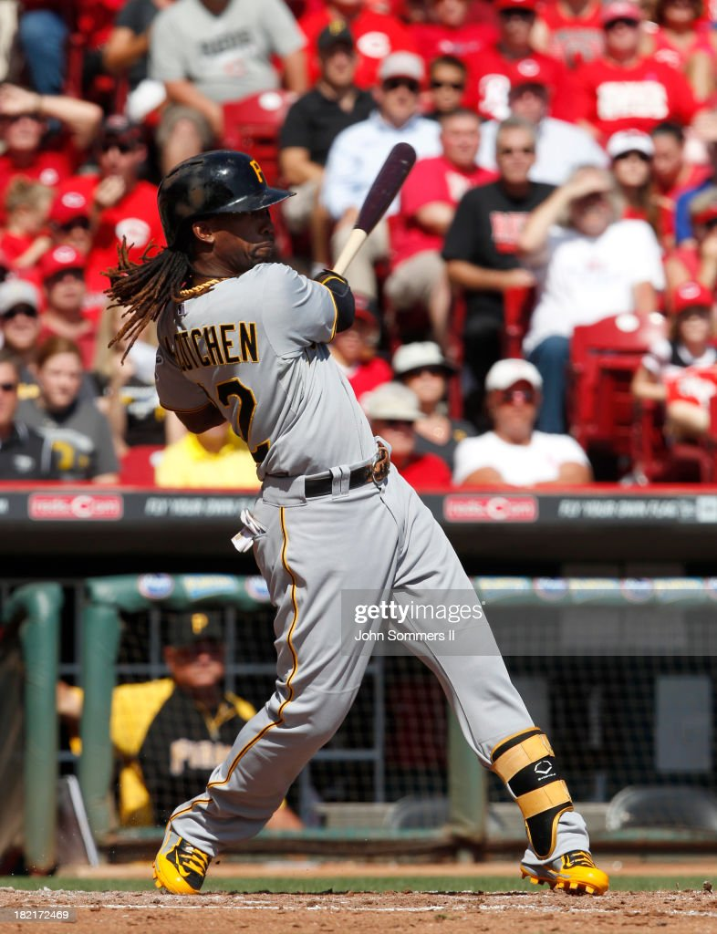 <a gi-track='captionPersonalityLinkClicked' href=/galleries/search?phrase=Andrew+McCutchen&family=editorial&specificpeople=2364814 ng-click='$event.stopPropagation()'>Andrew McCutchen</a> #22 of the Pittsburgh Pirates hits a solo homerun during their game against the Cincinnati Reds at Great American Ball Park on September 28, 2013 in Cincinnati, Ohio.