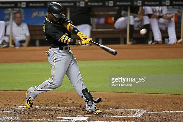 Andrew McCutchen of the Pittsburgh Pirates hits a three run home run during a game against the Miami Marlins at Marlins Park on August 26 2015 in...