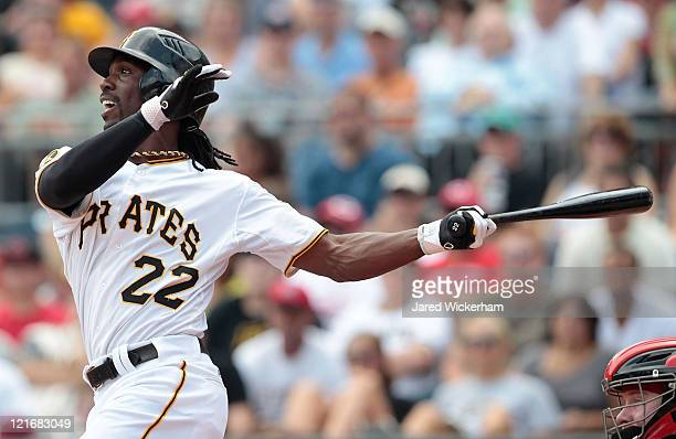 Andrew McCutchen of the Pittsburgh Pirates hits a two run home run against the Cincinnati Reds in the first inning during the game on August 21 2011...