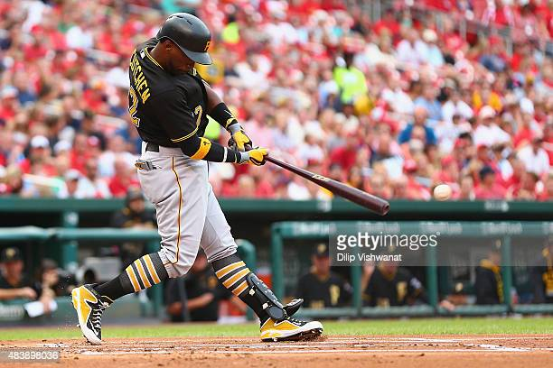 Andrew McCutchen of the Pittsburgh Pirates hits an RBI double against the St Louis Cardinals in the first inning at Busch Stadium on August 13 2015...