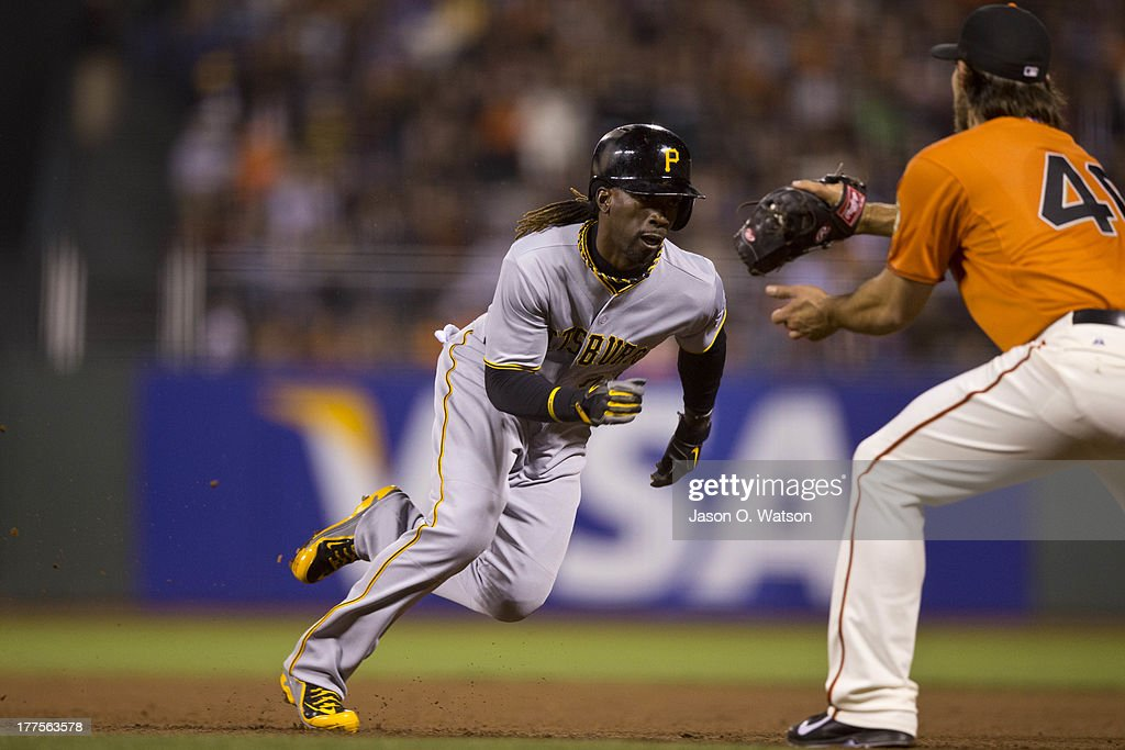 <a gi-track='captionPersonalityLinkClicked' href=/galleries/search?phrase=Andrew+McCutchen&family=editorial&specificpeople=2364814 ng-click='$event.stopPropagation()'>Andrew McCutchen</a> #22 of the Pittsburgh Pirates is caught stealing second base by <a gi-track='captionPersonalityLinkClicked' href=/galleries/search?phrase=Madison+Bumgarner&family=editorial&specificpeople=5974095 ng-click='$event.stopPropagation()'>Madison Bumgarner</a> #40 of the San Francisco Giants during the eighth inning at AT&T Park on August 23, 2013 in San Francisco, California.