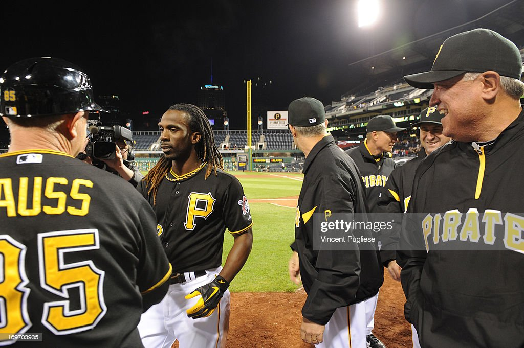 <a gi-track='captionPersonalityLinkClicked' href=/galleries/search?phrase=Andrew+McCutchen&family=editorial&specificpeople=2364814 ng-click='$event.stopPropagation()'>Andrew McCutchen</a> #22 of the Pittsburgh Pirates is congratulated by teammates after hitting a game winning home run against the Milwaukee Brewers at PNC Park on May 14, 2013 in Pittsburgh, Pennsylvania.