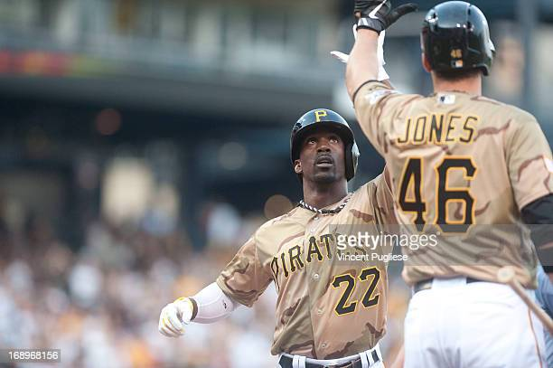 Andrew McCutchen of the Pittsburgh Pirates is congratulated by Garrett Jones after hitting a home run in the first inning against the Houston Astros...