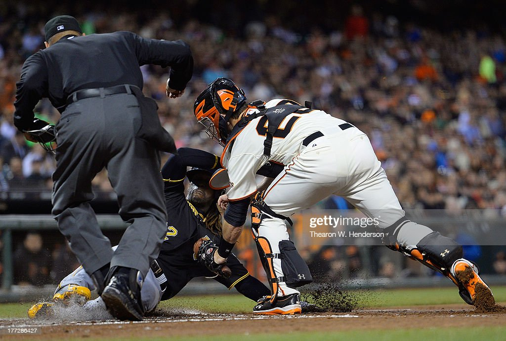 <a gi-track='captionPersonalityLinkClicked' href=/galleries/search?phrase=Andrew+McCutchen&family=editorial&specificpeople=2364814 ng-click='$event.stopPropagation()'>Andrew McCutchen</a> #22 of the Pittsburgh Pirates is tagged out at home plate by Buster Posey #28 of the San Francisco Giants in the third inning at AT&T Park on August 22, 2013 in San Francisco, California. McCutchen was attempting to score from third on a ground ball hit back to the pitcher.