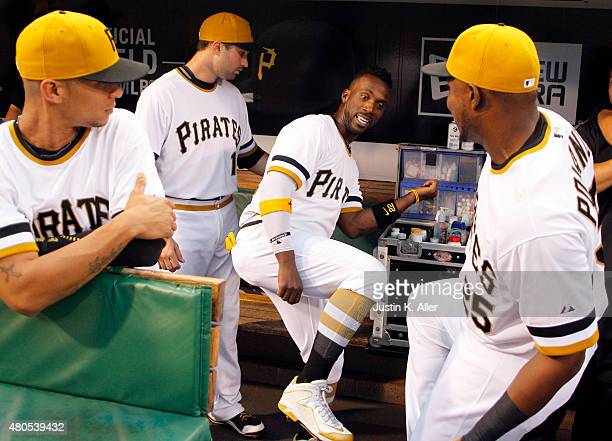 Andrew McCutchen of the Pittsburgh Pirates jokes around with teammates Gregory Polanco Neil Walker and Gorkys Hernandez before the game against the...