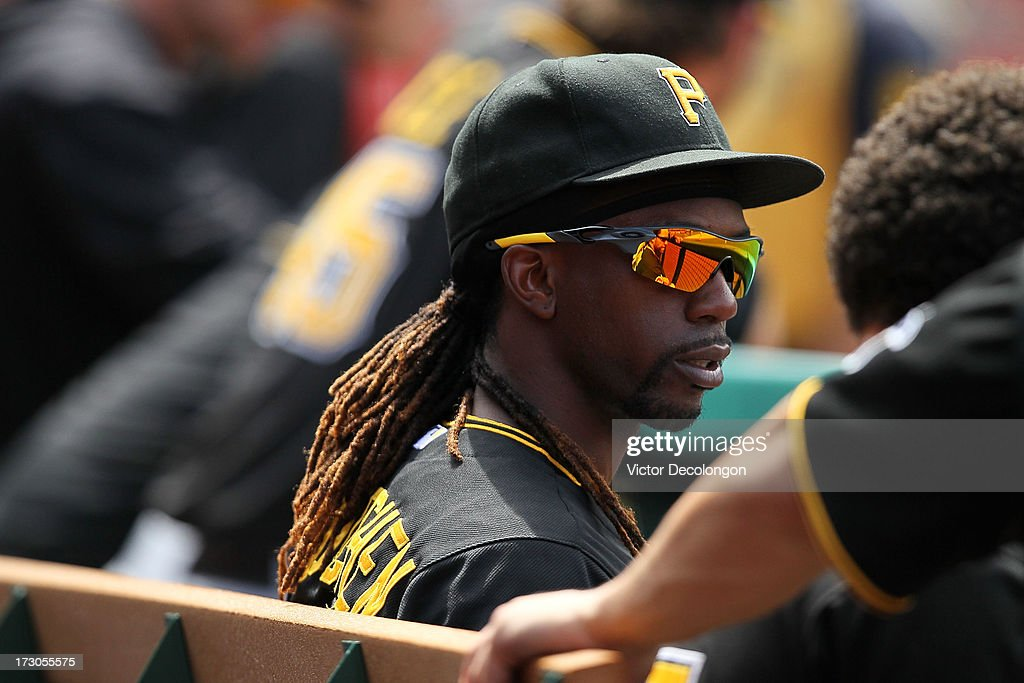 Andrew McCutchen #22 of the Pittsburgh Pirates looks on from the dugout during the MLB game against the Los Angeles Angels of Anaheim at Angel Stadium of Anaheim on June 23, 2013 in Anaheim, California. The Pirates defeated the Angels 10-9 in ten innings.