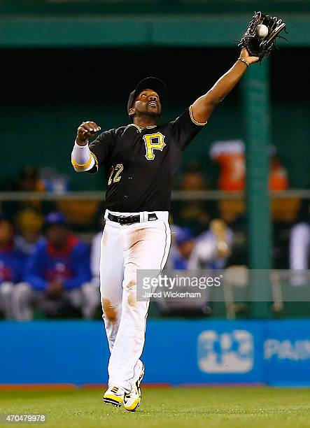 Andrew McCutchen of the Pittsburgh Pirates makes a catch in center field in the second inning against the Chicago Cubs during the game at PNC Park on...