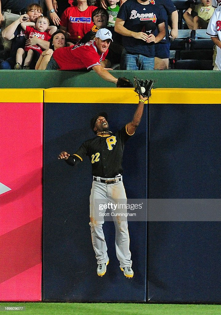 <a gi-track='captionPersonalityLinkClicked' href=/galleries/search?phrase=Andrew+McCutchen&family=editorial&specificpeople=2364814 ng-click='$event.stopPropagation()'>Andrew McCutchen</a> #22 of the Pittsburgh Pirates makes a catch in the ninth inning against the Atlanta Braves at Turner Field on June 4, 2013 in Atlanta, Georgia.