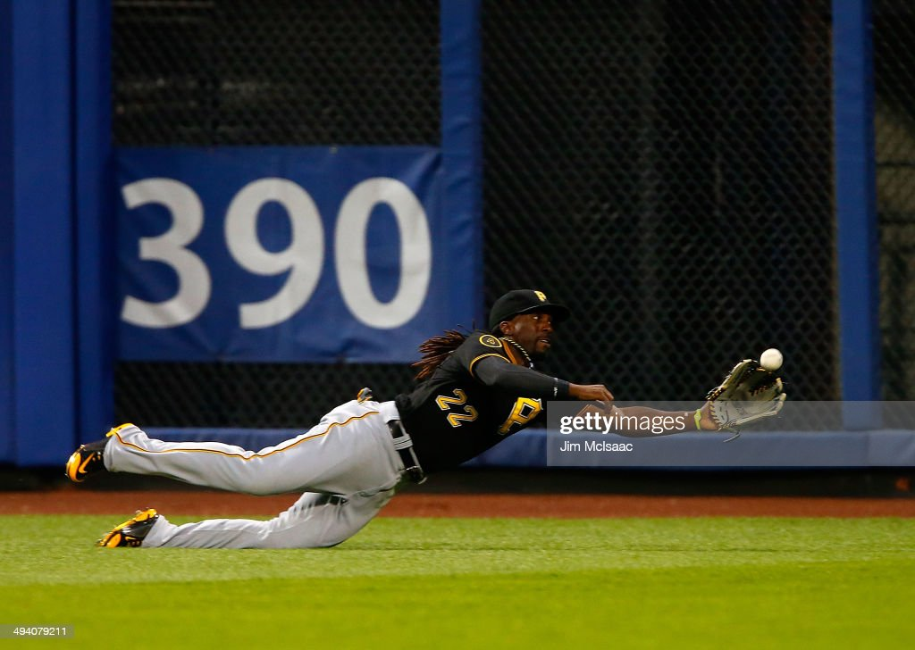 <a gi-track='captionPersonalityLinkClicked' href=/galleries/search?phrase=Andrew+McCutchen&family=editorial&specificpeople=2364814 ng-click='$event.stopPropagation()'>Andrew McCutchen</a> #22 of the Pittsburgh Pirates makes a catch on a ball hit by Juan Lagares #12 of the New York Mets in the third inning at Citi Field on May 27, 2014 in the Flushing neighborhood of the Queens borough of New York City.