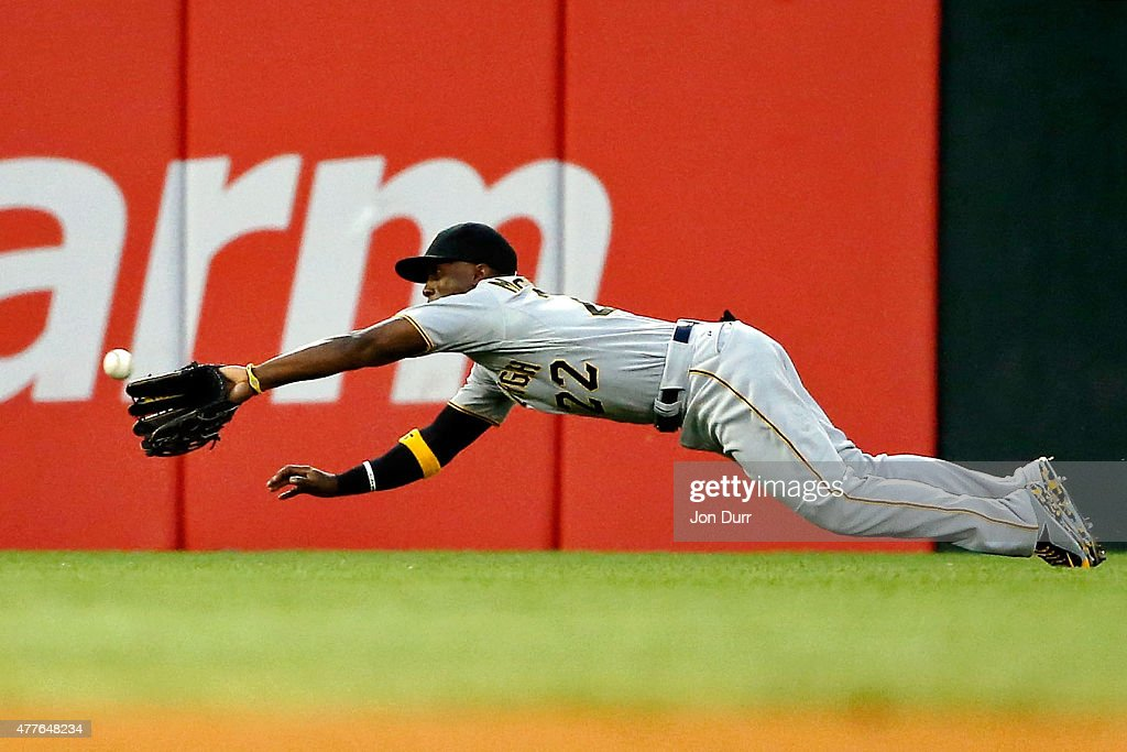 Andrew McCutchen of the Pittsburgh Pirates makes a diving catch for an out against the Chicago White Sox during the fourth inning at US Cellular...