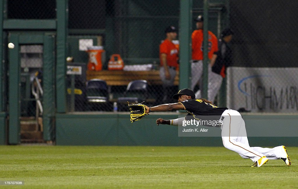 <a gi-track='captionPersonalityLinkClicked' href=/galleries/search?phrase=Andrew+McCutchen&family=editorial&specificpeople=2364814 ng-click='$event.stopPropagation()'>Andrew McCutchen</a> #22 of the Pittsburgh Pirates makes a diving catch in the seventh inning against the Miami Marlins during the game on August 6, 2013 at PNC Park in Pittsburgh, Pennsylvania.