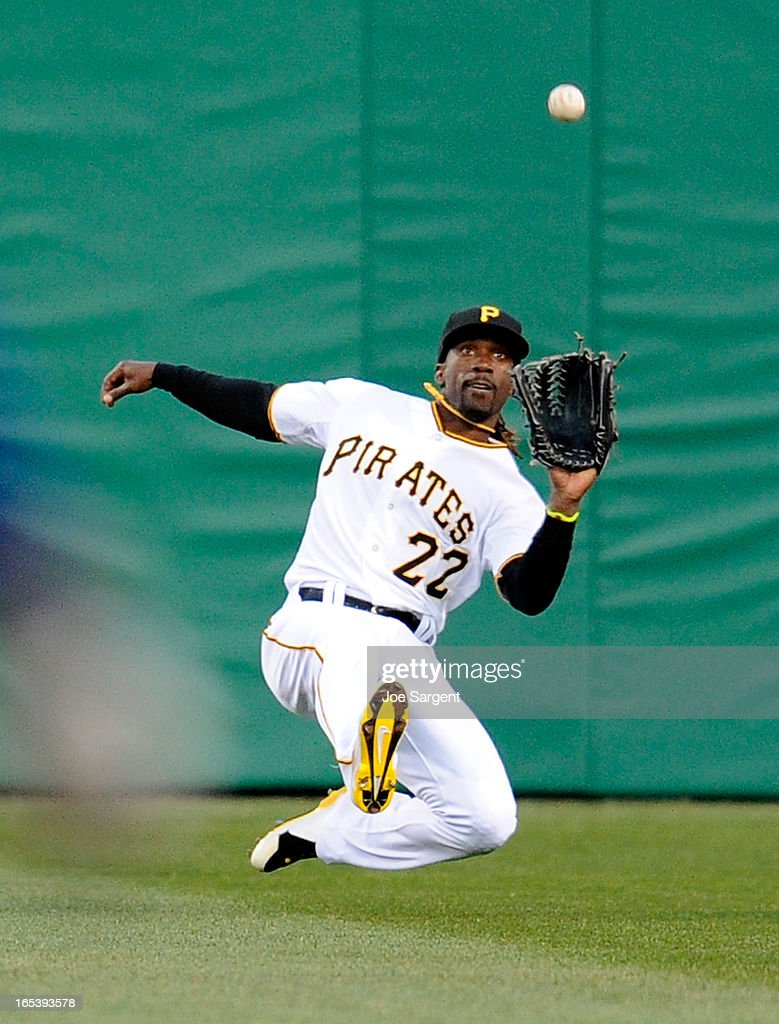 Andrew McCutchen of the Pittsburgh Pirates makes a diving catch during the second inning against the Chicago Cubs on April 3 2013 at PNC Park in...
