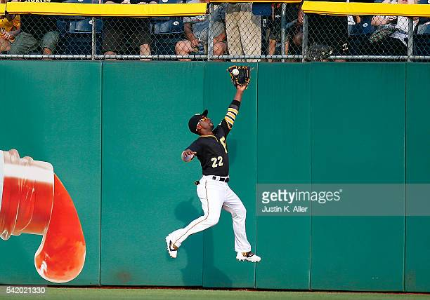 Andrew McCutchen of the Pittsburgh Pirates makes a running catch in the second inning during the game against the San Francisco Giants at PNC Park on...