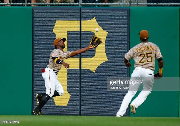 Andrew McCutchen of the Pittsburgh Pirates makes a running catch in the second inning against the Cincinnati Reds at PNC Park on August 3 2017 in...