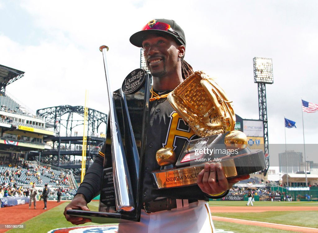 <a gi-track='captionPersonalityLinkClicked' href=/galleries/search?phrase=Andrew+McCutchen&family=editorial&specificpeople=2364814 ng-click='$event.stopPropagation()'>Andrew McCutchen</a> #22 of the Pittsburgh Pirates poses with his 2012 Rawlings Gold Glove award and Silver Slugger award before the opening day game against the Chicago Cubs on April 1, 2013 at PNC Park in Pittsburgh, Pennsylvania.