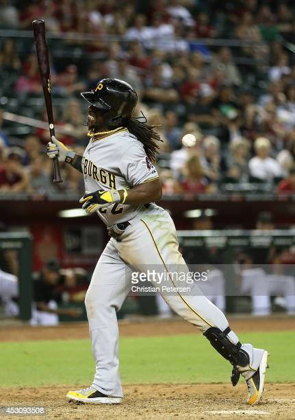 Andrew McCutchen of the Pittsburgh Pirates reacts after being hit by a pitch from the Arizona Diamondbacks during the ninth inning of the MLB game at...
