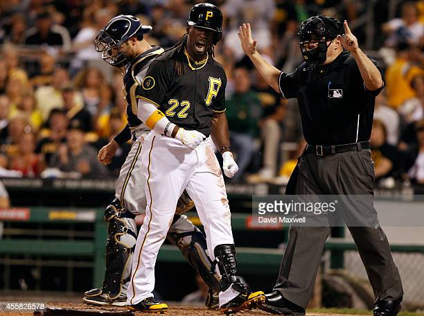 Andrew McCutchen of the Pittsburgh Pirates reacts after being hit by a pitch for the second time in the game against of the Milwaukee Brewers as home...