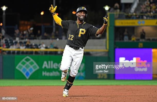 Andrew McCutchen of the Pittsburgh Pirates reacts as he rounds the bases after hitting a grand slam home run in the second inning during the game...