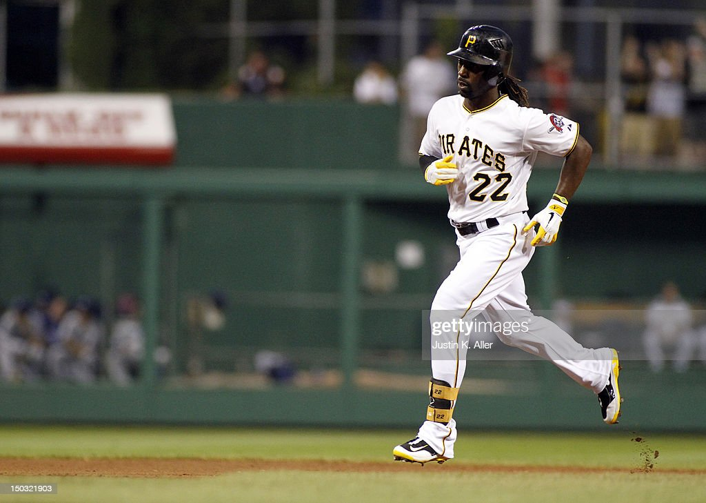 <a gi-track='captionPersonalityLinkClicked' href=/galleries/search?phrase=Andrew+McCutchen&family=editorial&specificpeople=2364814 ng-click='$event.stopPropagation()'>Andrew McCutchen</a> #22 of the Pittsburgh Pirates rounds second after hitting a solo home run in the fourth inning against the Los Angeles Dodgers during the game on August 15, 2012 at PNC Park in Pittsburgh, Pennsylvania.