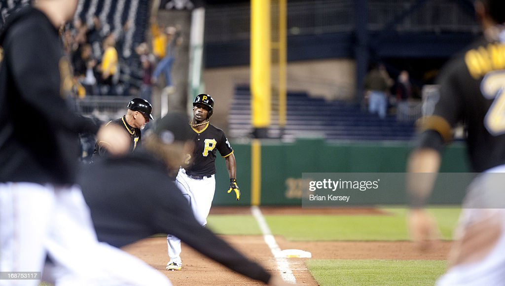 <a gi-track='captionPersonalityLinkClicked' href=/galleries/search?phrase=Andrew+McCutchen&family=editorial&specificpeople=2364814 ng-click='$event.stopPropagation()'>Andrew McCutchen</a> #22 of the Pittsburgh Pirates rounds the bases after hitting a walk-off home run in the 12th inning to defeat the Milwaukee Brewers 4-3 at PNC Park on May 14, 2013 in Pittsburgh, Pennsylvania.