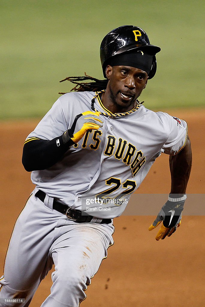 <a gi-track='captionPersonalityLinkClicked' href=/galleries/search?phrase=Andrew+McCutchen&family=editorial&specificpeople=2364814 ng-click='$event.stopPropagation()'>Andrew McCutchen</a> #22 of the Pittsburgh Pirates rounds third base to score during a game against the Miami Marlins at Marlins Park on May 14, 2012 in Miami, Florida. The Pirates defeated the Marlins 3-2.