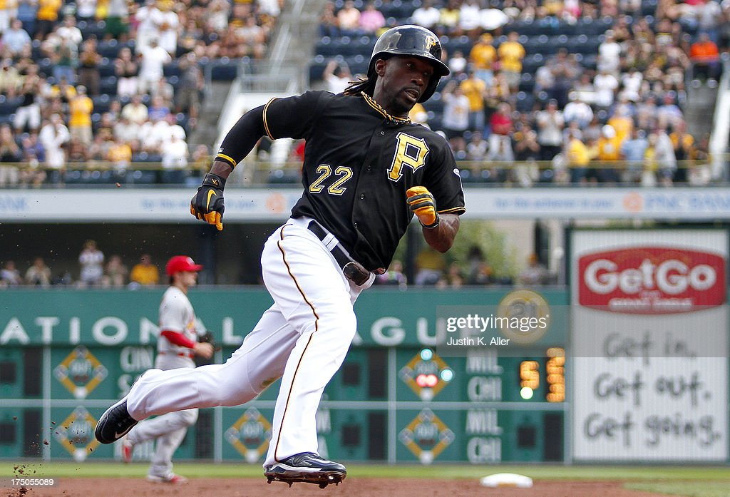 <a gi-track='captionPersonalityLinkClicked' href=/galleries/search?phrase=Andrew+McCutchen&family=editorial&specificpeople=2364814 ng-click='$event.stopPropagation()'>Andrew McCutchen</a> #22 of the Pittsburgh Pirates rounds third on an RBI double by teammate Pedro Alvarez #24 in the first inning against the St. Louis Cardinals during the game on July 30, 2013 at PNC Park in Pittsburgh, Pennsylvania.