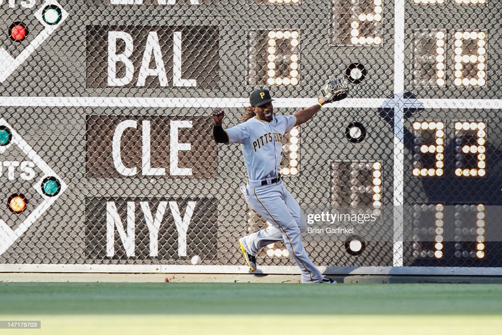 <a gi-track='captionPersonalityLinkClicked' href=/galleries/search?phrase=Andrew+McCutchen&family=editorial&specificpeople=2364814 ng-click='$event.stopPropagation()'>Andrew McCutchen</a> #22 of the Pittsburgh Pirates runs past a long ball in the first inning of the game against the Philadelphia Phillies at Citizens Bank Park on June 26, 2012 in Philadelphia, Pennsylvania.