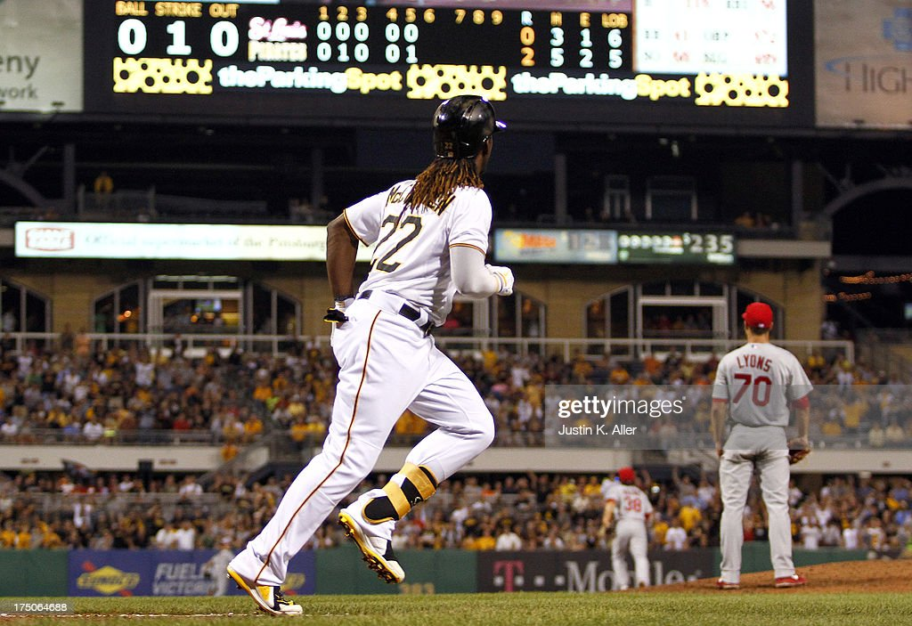 <a gi-track='captionPersonalityLinkClicked' href=/galleries/search?phrase=Andrew+McCutchen&family=editorial&specificpeople=2364814 ng-click='$event.stopPropagation()'>Andrew McCutchen</a> #22 of the Pittsburgh Pirates runs the bases after hitting a two-run home run in the fifth inning against the St. Louis Cardinals during game two of a doubleheader on July 30, 2013 at PNC Park in Pittsburgh, Pennsylvania.