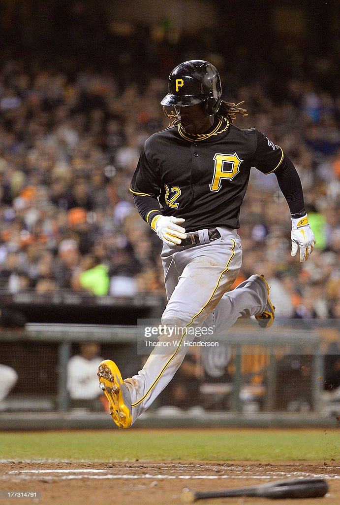 <a gi-track='captionPersonalityLinkClicked' href=/galleries/search?phrase=Andrew+McCutchen&family=editorial&specificpeople=2364814 ng-click='$event.stopPropagation()'>Andrew McCutchen</a> #22 of the Pittsburgh Pirates scores from third base on a sacrifice fly from Russell Martin #55 in the fifth inning against the San Francisco Giants at AT&T Park on August 22, 2013 in San Francisco, California.