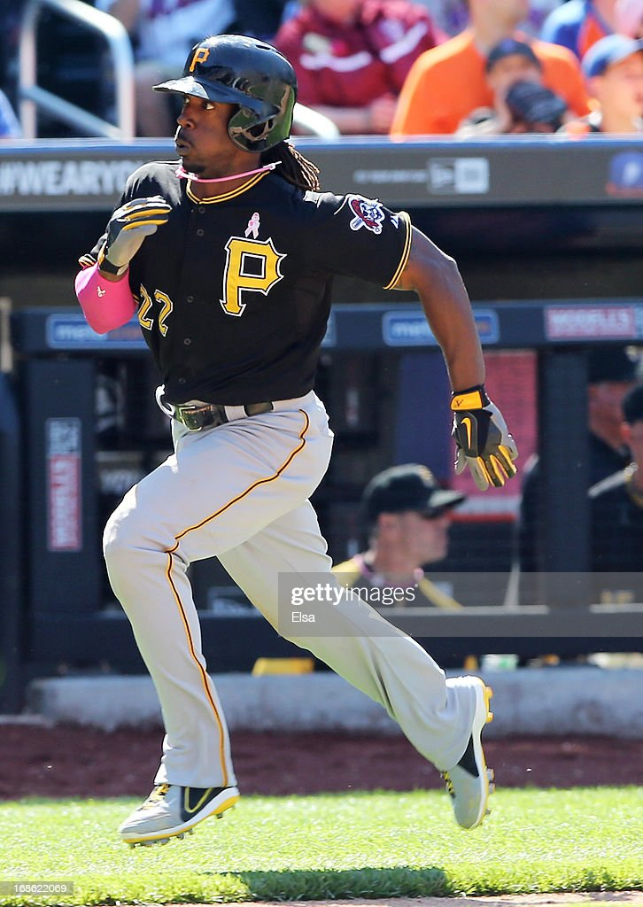 <a gi-track='captionPersonalityLinkClicked' href=/galleries/search?phrase=Andrew+McCutchen&family=editorial&specificpeople=2364814 ng-click='$event.stopPropagation()'>Andrew McCutchen</a> #22 of the Pittsburgh Pirates scores on a double in the eighth inning against the New York Mets on May 12, 2013 at Citi Field in the Flushing neighborhood of the Queens borough of New York City.