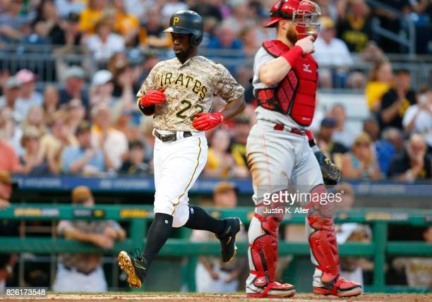 Andrew McCutchen of the Pittsburgh Pirates scores on a RBI single in the third inning against the Cincinnati Reds at PNC Park on August 3 2017 in...