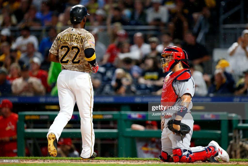 Andrew McCutchen #22 of the Pittsburgh Pirates scores on a RBI single in the third inning against Yadier Molina #4 of the St. Louis Cardinals at PNC Park on August 17, 2017 in Pittsburgh, Pennsylvania.
