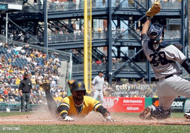 Andrew McCutchen of the Pittsburgh Pirates scores on an RBI double in the third inning against Kyle Higashioka of the New York Yankees at PNC Park on...