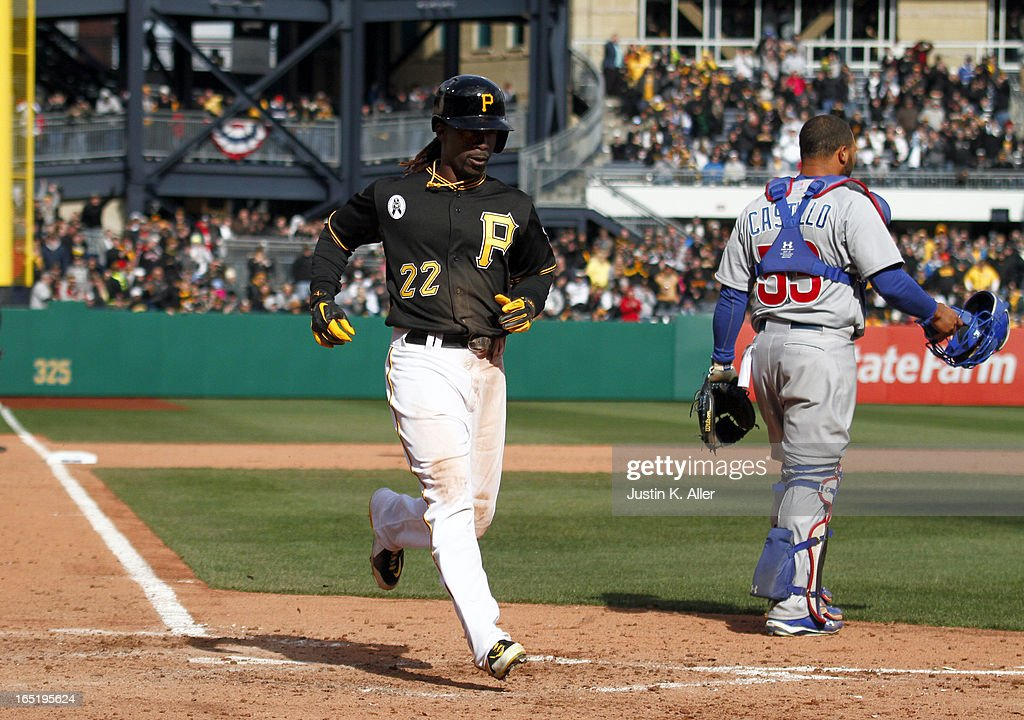 Andrew McCutchen #22 of the Pittsburgh Pirates scores on an RBI single in the ninth inning by Pedro Alvarez #24 (not pictured) against the Chicago Cubs during the opening day game on April 1, 2013 at PNC Park in Pittsburgh, Pennsylvania. The Cubs defeated the Pirates 3-1.