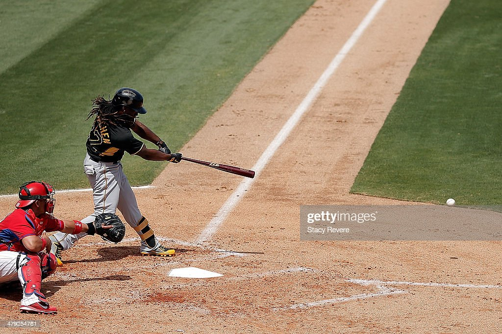 Andrew McCutchen #22 of the Pittsburgh Pirates swings at a pitch in the third inning of a game against the Philadelphia Phillies at Bright House Field on March 16, 2014 in Clearwater, Florida. Pittsburgh won the game 5-0.