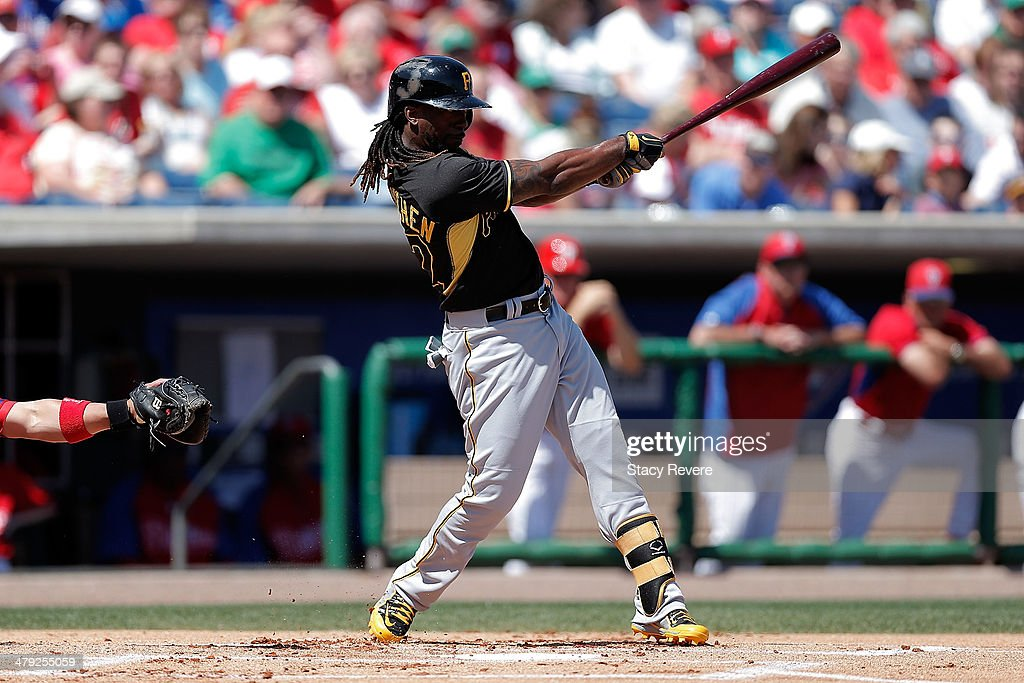Andrew McCutchen #22 of the Pittsburgh Pirates swings at a pitch in the first inning of a game against the Philadelphia Phillies at Bright House Field on March 16, 2014 in Clearwater, Florida. Pittsburgh won the game 5-0.