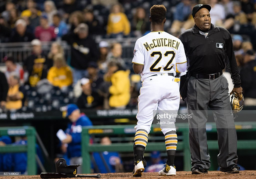 Andrew McCutchen of the Pittsburgh Pirates talks with home plate umpire Laz Diaz after striking out in the seventh inning during the game against the...