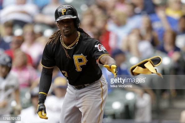 Andrew McCutchen of the Pittsburgh Pirates throws his shin guard after drawing ball four for a walk in the top of the third inning against the...