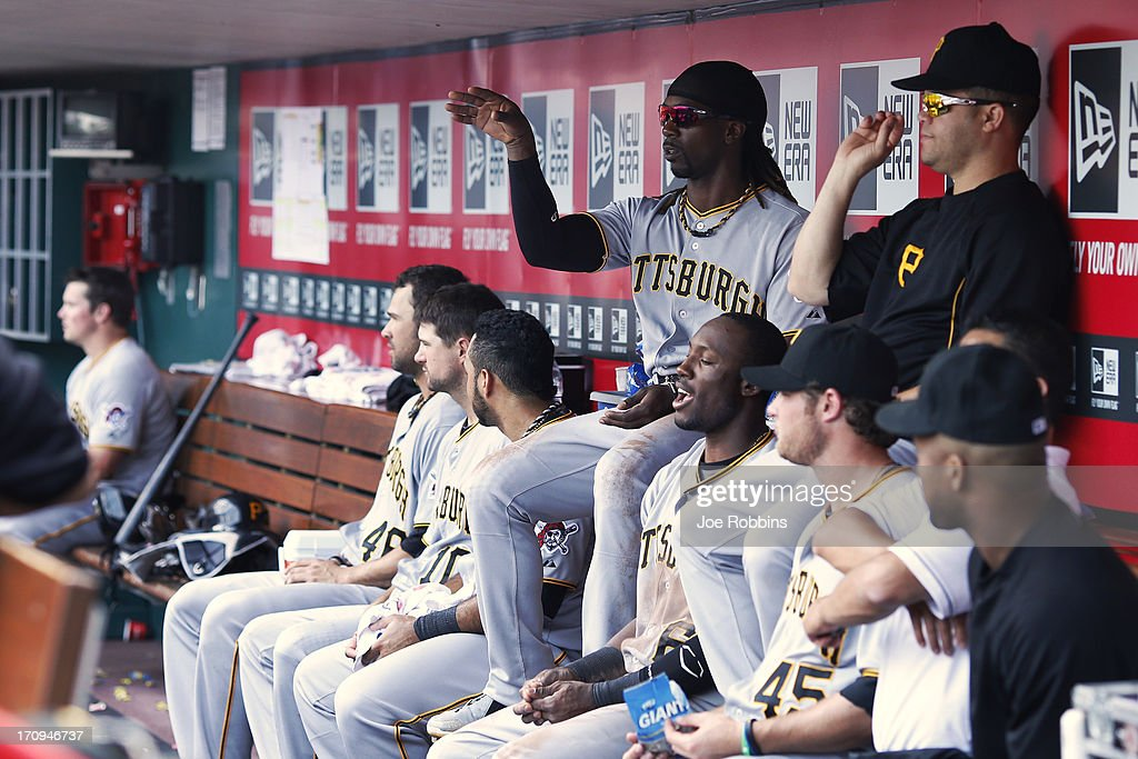 <a gi-track='captionPersonalityLinkClicked' href=/galleries/search?phrase=Andrew+McCutchen&family=editorial&specificpeople=2364814 ng-click='$event.stopPropagation()'>Andrew McCutchen</a> #22 of the Pittsburgh Pirates tosses sunflower seeds into a cup along with teammates while sitting in the dugout during the game against the Cincinnati Reds at Great American Ball Park on June 20, 2013 in Cincinnati, Ohio. The Pirates won 5-3.