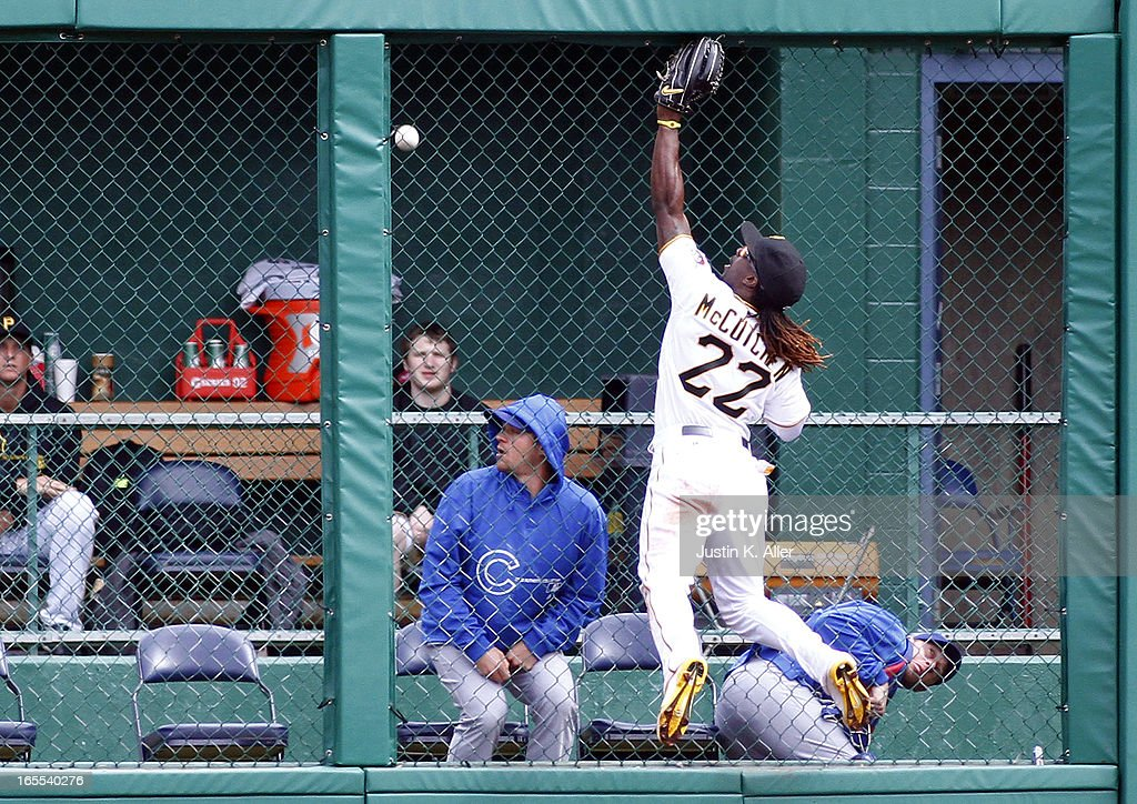 <a gi-track='captionPersonalityLinkClicked' href=/galleries/search?phrase=Andrew+McCutchen&family=editorial&specificpeople=2364814 ng-click='$event.stopPropagation()'>Andrew McCutchen</a> #22 of the Pittsburgh Pirates tracks the home run ball of Nate Schierholtz #19 of the Chicago Cubs (not pictured) in the ninth inning during the game on April 4, 2013 at PNC Park in Pittsburgh, Pennsylvania. The Cubs defeated the Pirates 3-2.