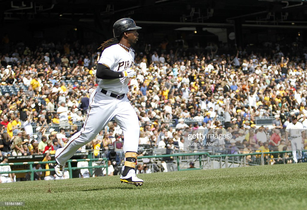 <a gi-track='captionPersonalityLinkClicked' href=/galleries/search?phrase=Andrew+McCutchen&family=editorial&specificpeople=2364814 ng-click='$event.stopPropagation()'>Andrew McCutchen</a> #22 of the Pittsburgh Pirates trots down the first base line after hitting a home run in the first inning against the Chicago Cubs during the game on September 9, 2012 at PNC Park in Pittsburgh, Pennsylvania.