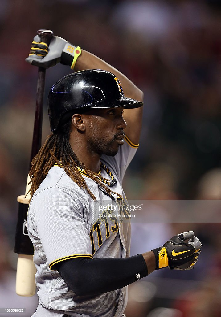 <a gi-track='captionPersonalityLinkClicked' href=/galleries/search?phrase=Andrew+McCutchen&family=editorial&specificpeople=2364814 ng-click='$event.stopPropagation()'>Andrew McCutchen</a> #22 of the Pittsburgh Pirates warms up on deck during the MLB game against the Arizona Diamondbacks at Chase Field on April 9, 2013 in Phoenix, Arizona.