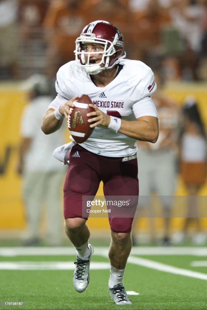 Andrew McDonald #12 of the New Mexico State Aggies scrambles against the Texas Longhorns on August 31, 2013 at Darrell K Royal-Texas Memorial Stadium in Austin, Texas.