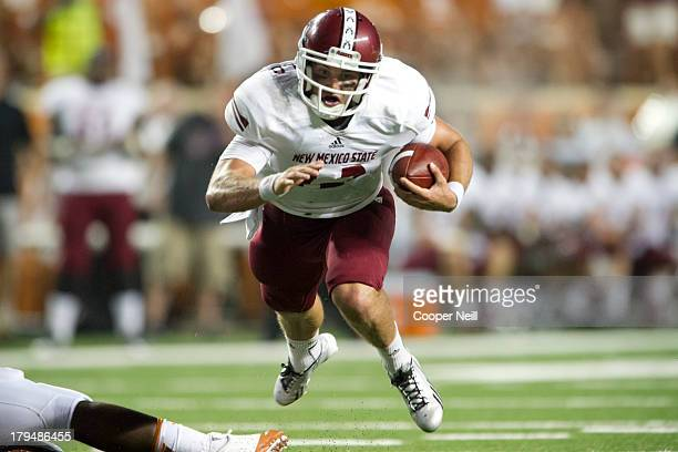 Andrew McDonald of the New Mexico State Aggies scrambles against the Texas Longhorns on August 31 2013 at Darrell K Royal Texas Memorial Stadium in...