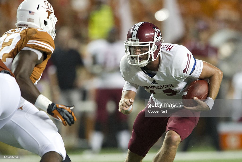 Andrew McDonald #12 of the New Mexico State Aggies scrambles against the Texas Longhorns on August 31, 2013 at Darrell K. Royal Texas Memorial Stadium in Austin, Texas.