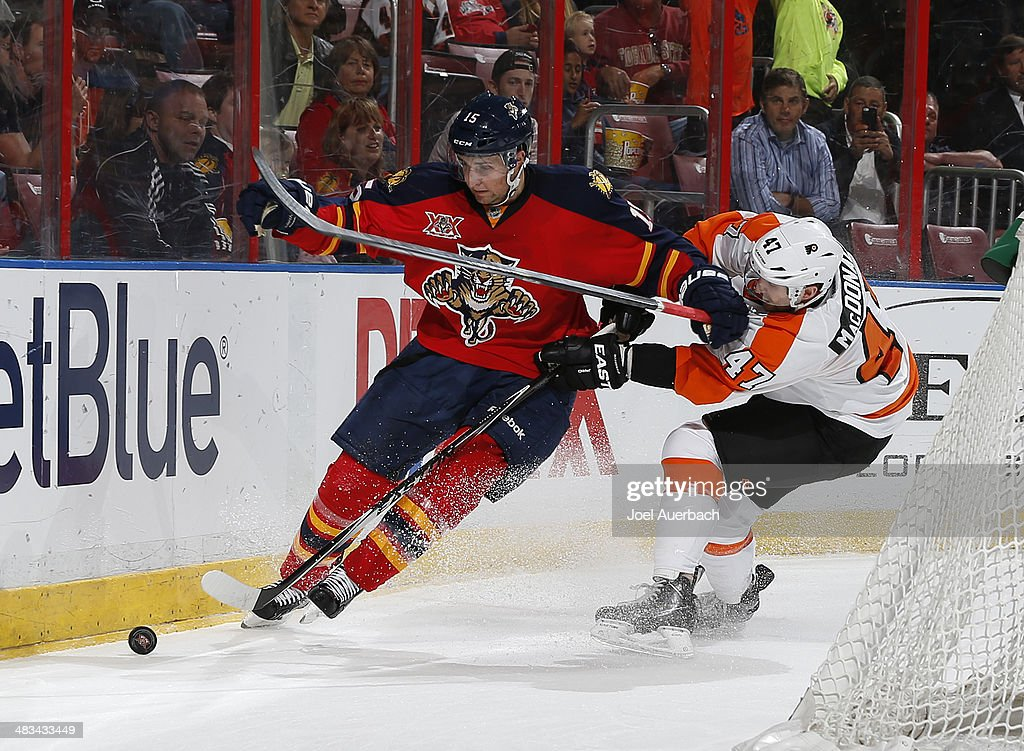Andrew McDonald #47 of the Philadelphia Flyers and Drew Shore #15 of the Florida Panthers battle for control of the puck behind the net at the BB&T Center on April 8, 2014 in Sunrise, Florida.