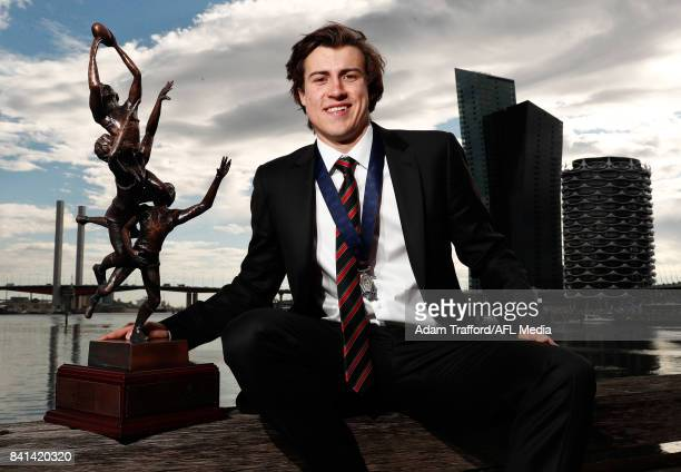 Andrew McGrath of the Bombers holds the trophy and Ron Evans medal for the Rising Star award during the 2017 NAB AFL Rising Star awards at Peninsula...