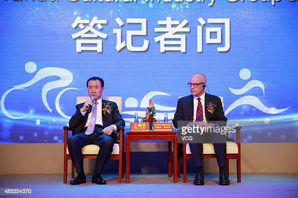 Andrew Messick chief executive officer of World Triathlon Corporation and Wang Jianlin chairman of Wanda Group attend the signing ceremony for Wanda...