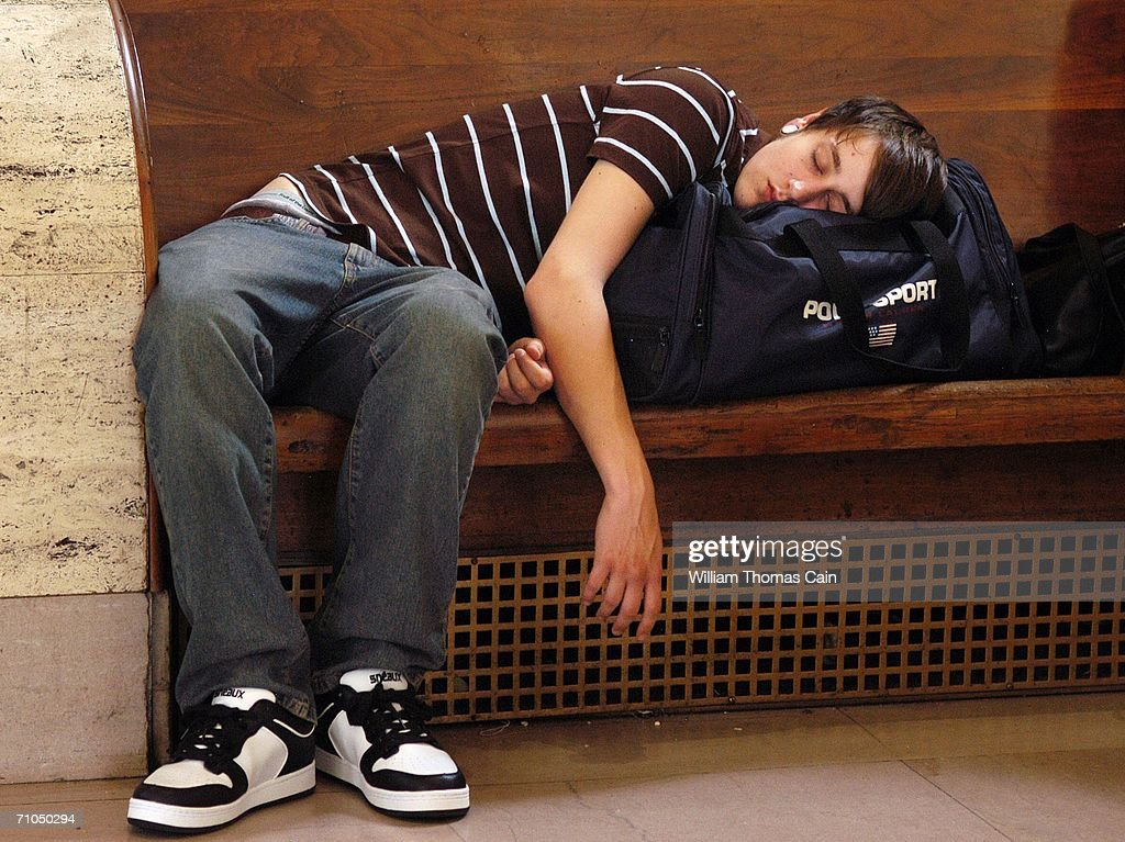 Andrew Michael who had been waiting for hours takes a nap as he waits for a train at 30th Street Station May 25 2006 in Philadelphia Pennsylvania...