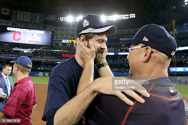 Andrew Miller and Manager Terry Francona of the Cleveland Indians celebrate after defeating the Toronto Blue Jays with a score of 3 to 0 in game five...